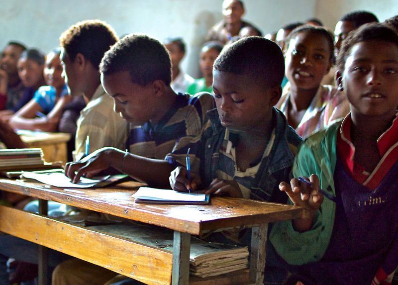 Stock A Classroom with Desks - Holt International Gifts of Hope